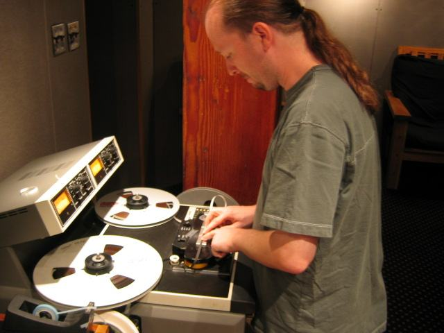 Chris Garges splicing 2-track tape on an ATR machine